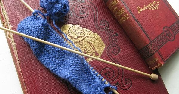 knitting and reading   the knitting space